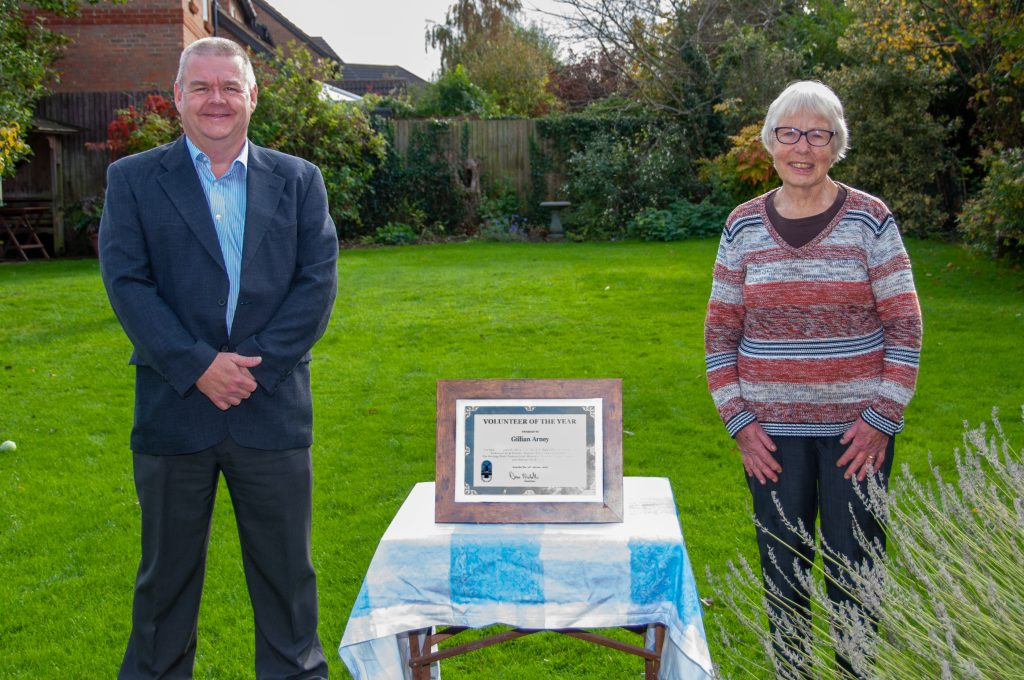 Photograph of Mrs Gillian Arney and Parish Council Chairman Dave Nicholls with Volunteer of Year framed certificate